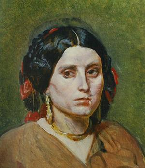 Голова молодой женщины с серьгами и ожерельем